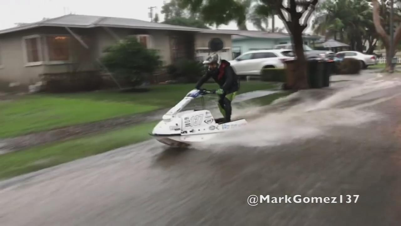 A man rode his Jet Ski through the streets of Fullerton after intense rain pounded Southern California on Sunday, Jan. 22, 2017.