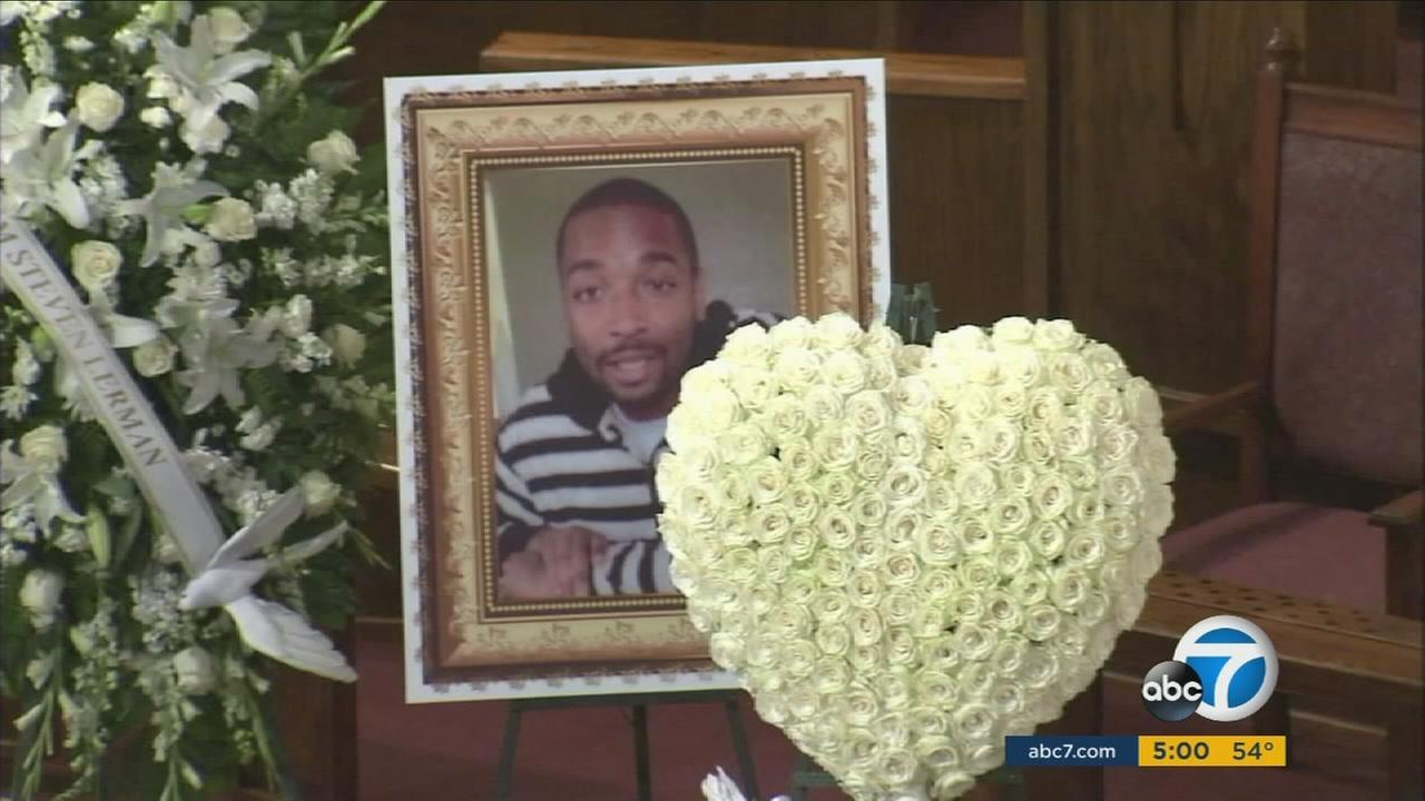 A photo of Ezell Ford is shown during a memorial service.