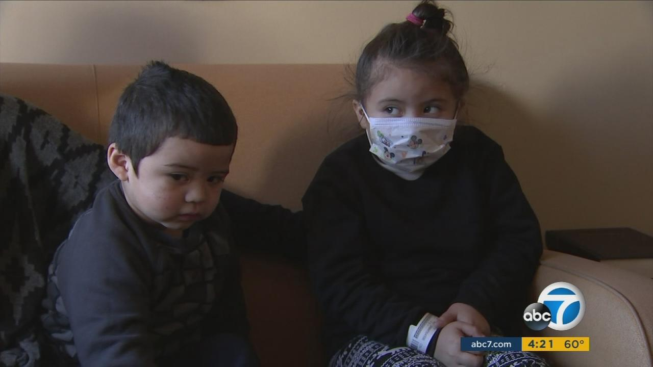 Two children wait for the doctor in a waiting room while they suffer from RSV.