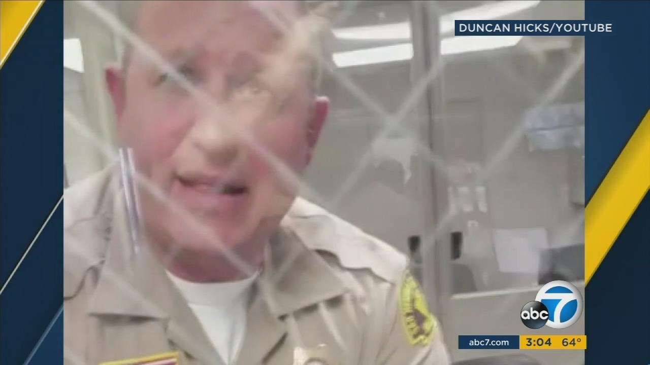 A sheriffs deputy seen on video threatening a man at the San Bernardino Sheriffs Department Victorville station.