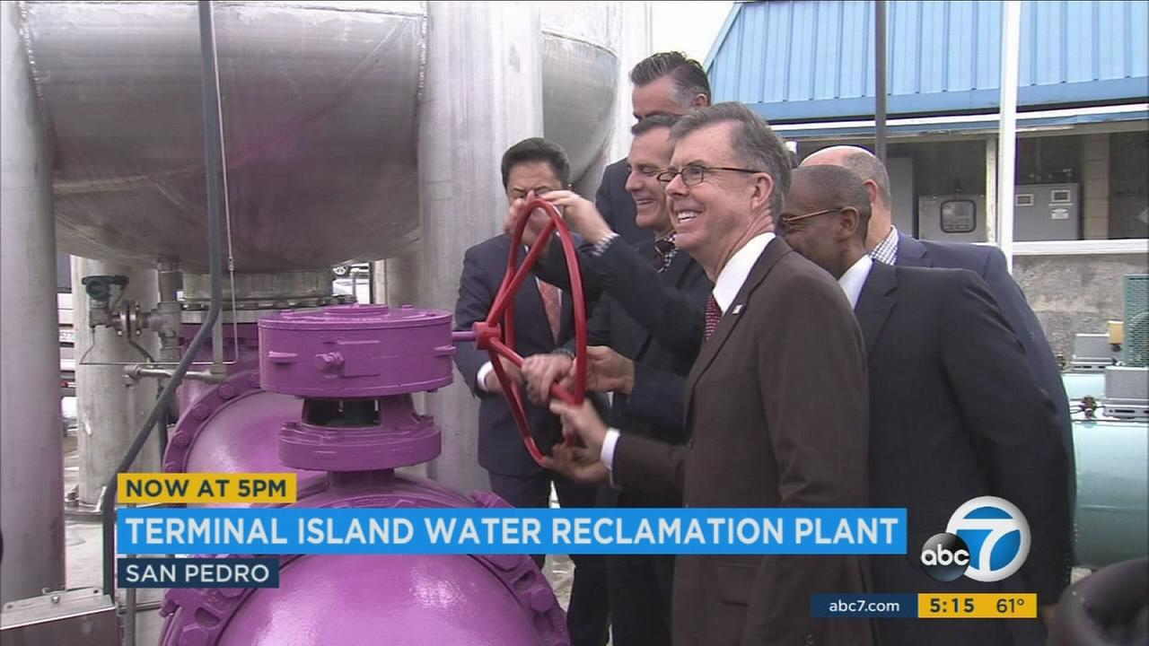 Los Angeles officials turn a wheel during an event kicking off water recycling at a treatment plant expansion on Terminal Island.