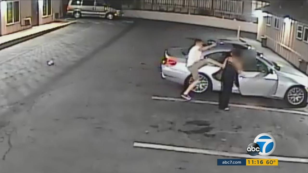 Surveillance video shows a man kicking his girlfriend outside a Chula Vista motel on Saturday, Aug. 6, 2016.
