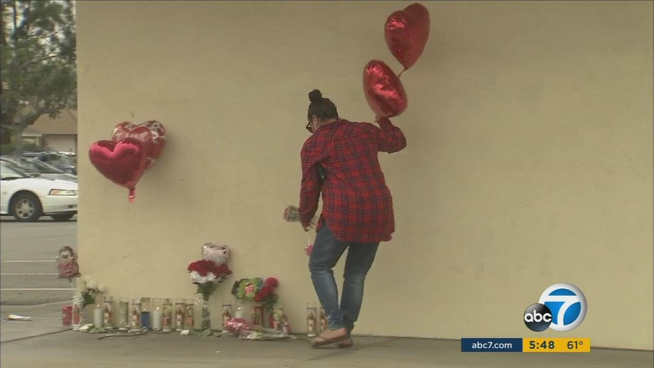 A woman was killed in Santa Ana by a hit-and-run driver at the scene of a memorial for a man shot 24 hours earlier.