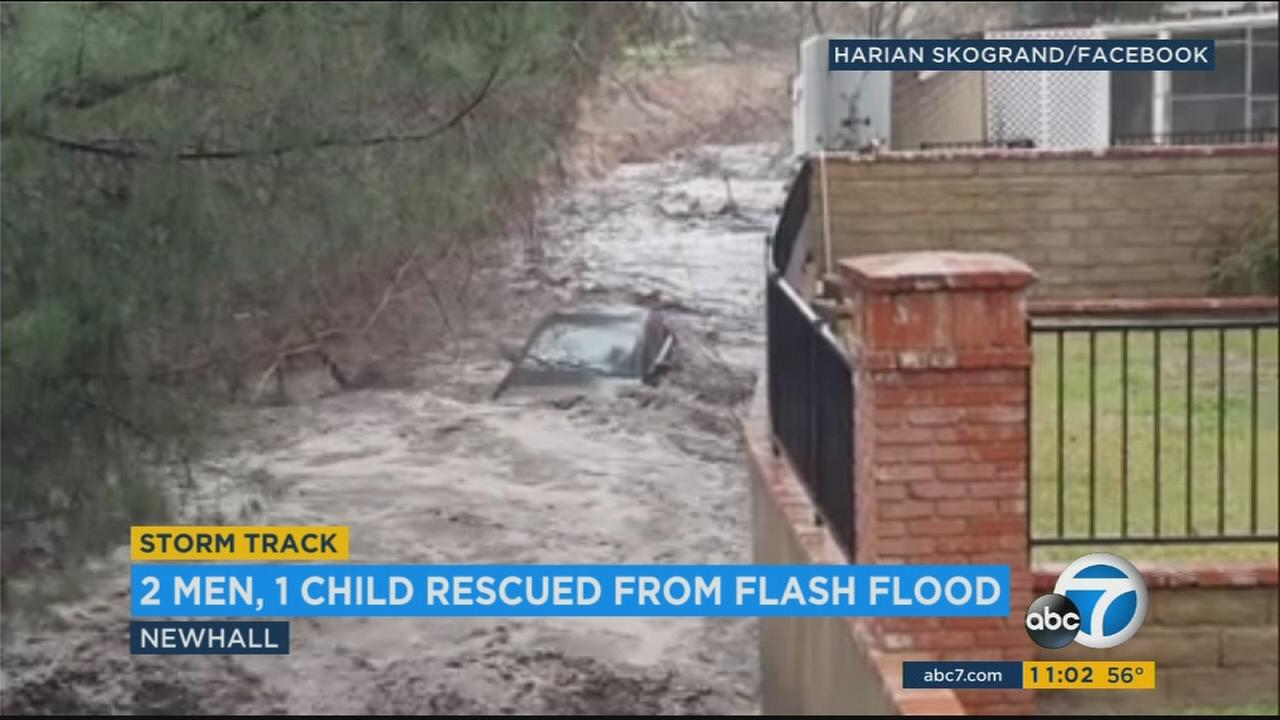 Three people were rescued when two cars were caught up in flash flooding in Newhall Saturday afternoon.