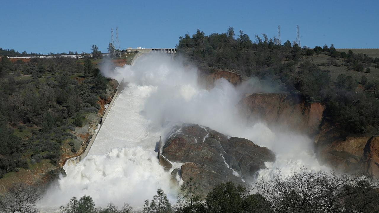 In this Saturday, Feb. 11, 2017, water flows down Oroville Dams main spillway near Oroville, Calif. Officials have ordered residents near the Oroville Dam in Northern California.