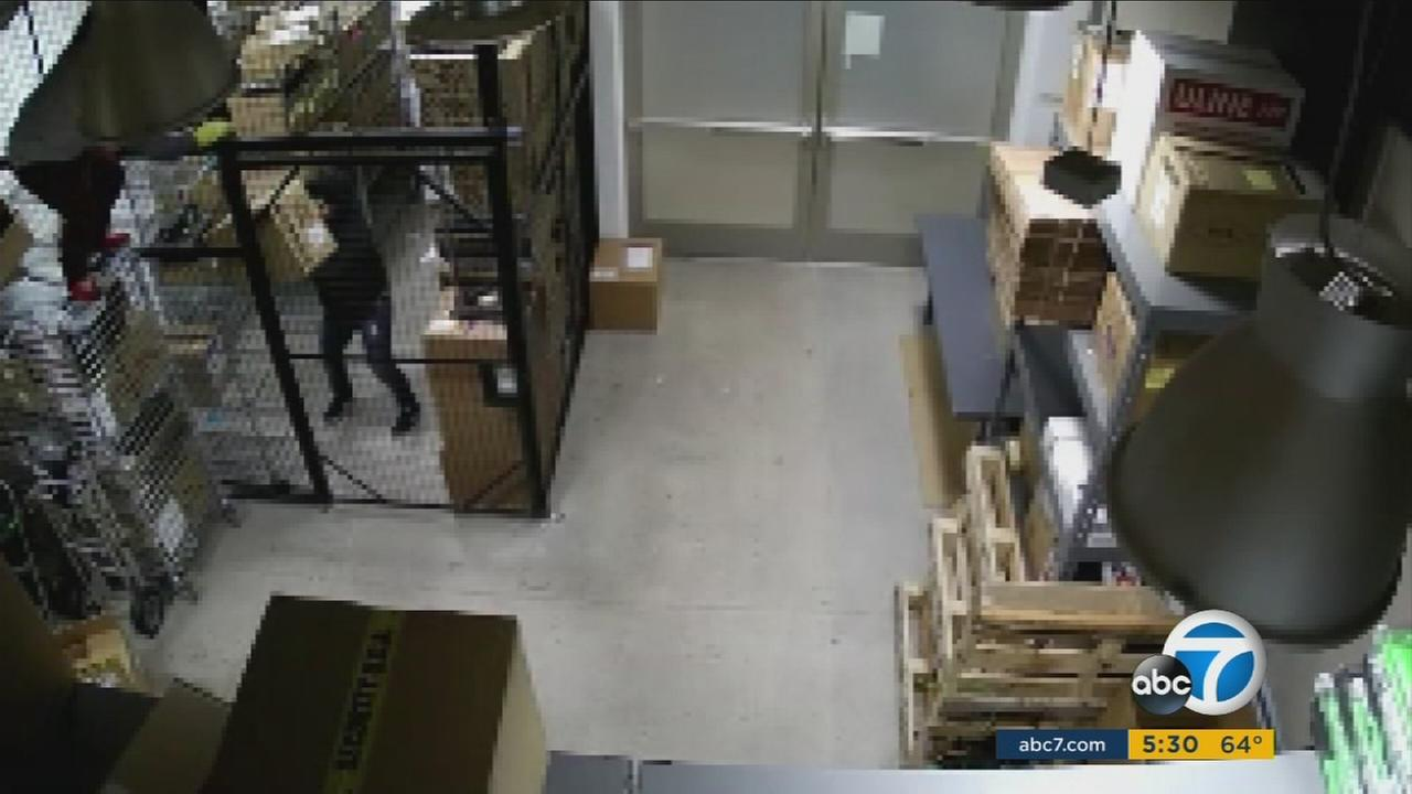 Irvine police are looking for a trio of hooded burglars who were caught on surveillance camera breaking into two different businesses, making off with $500,000 in merchandise.