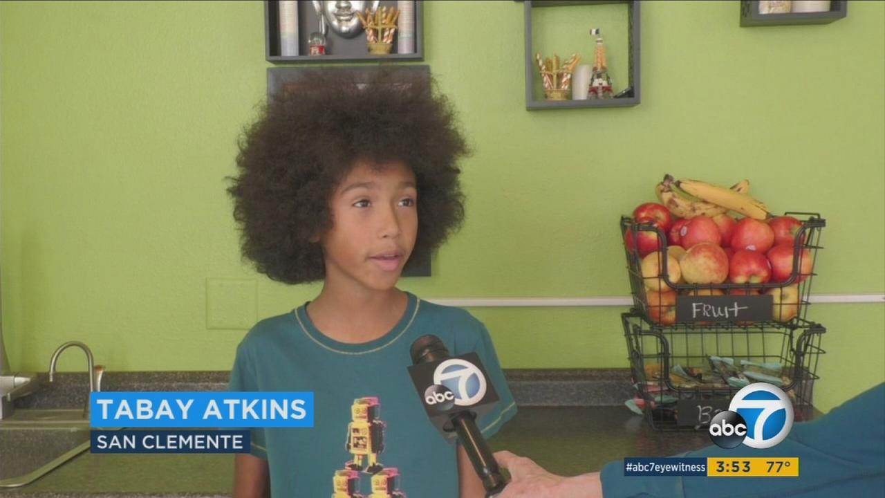Tabay Atkins, a young yoga instructor, is shown during an interview with ABC7 Food Coach Lori Corbin.