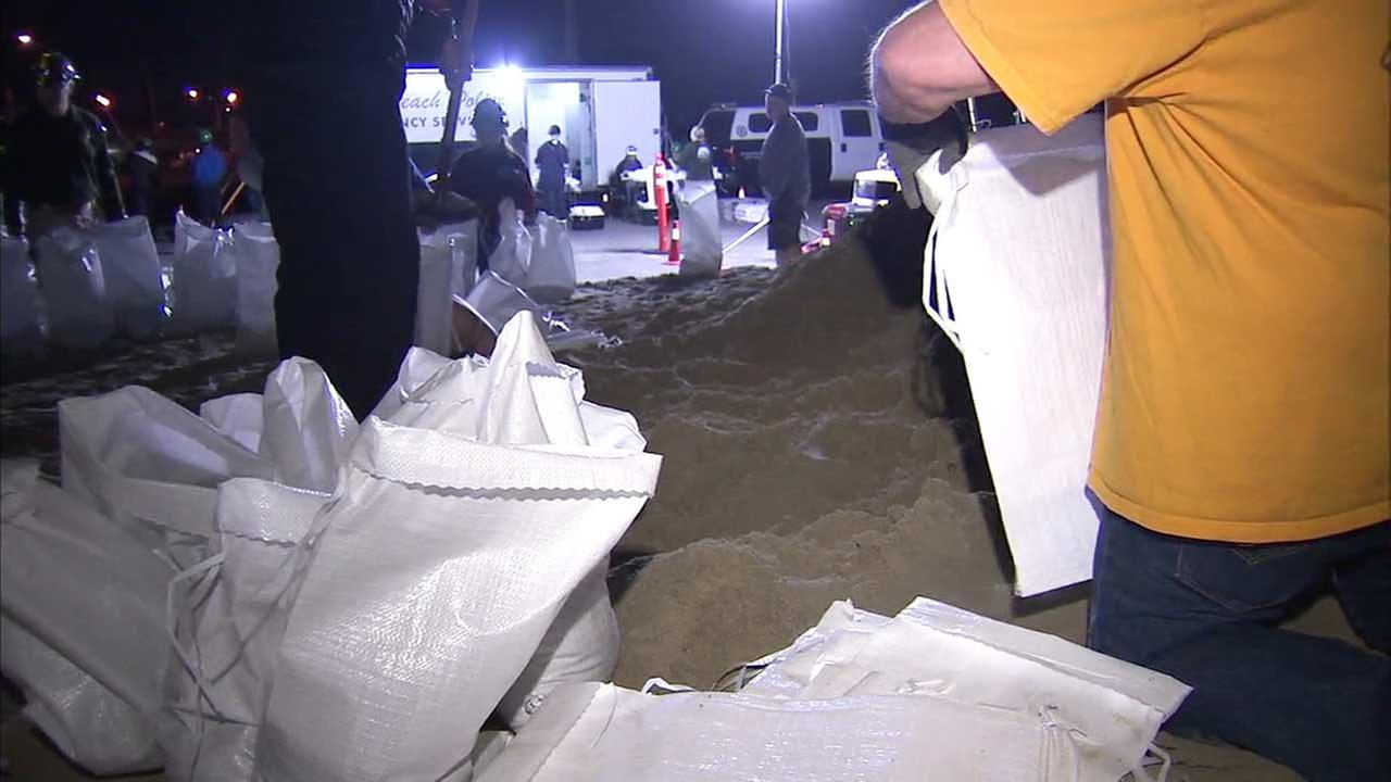 Volunteers fill sandbags in Seal Beach.