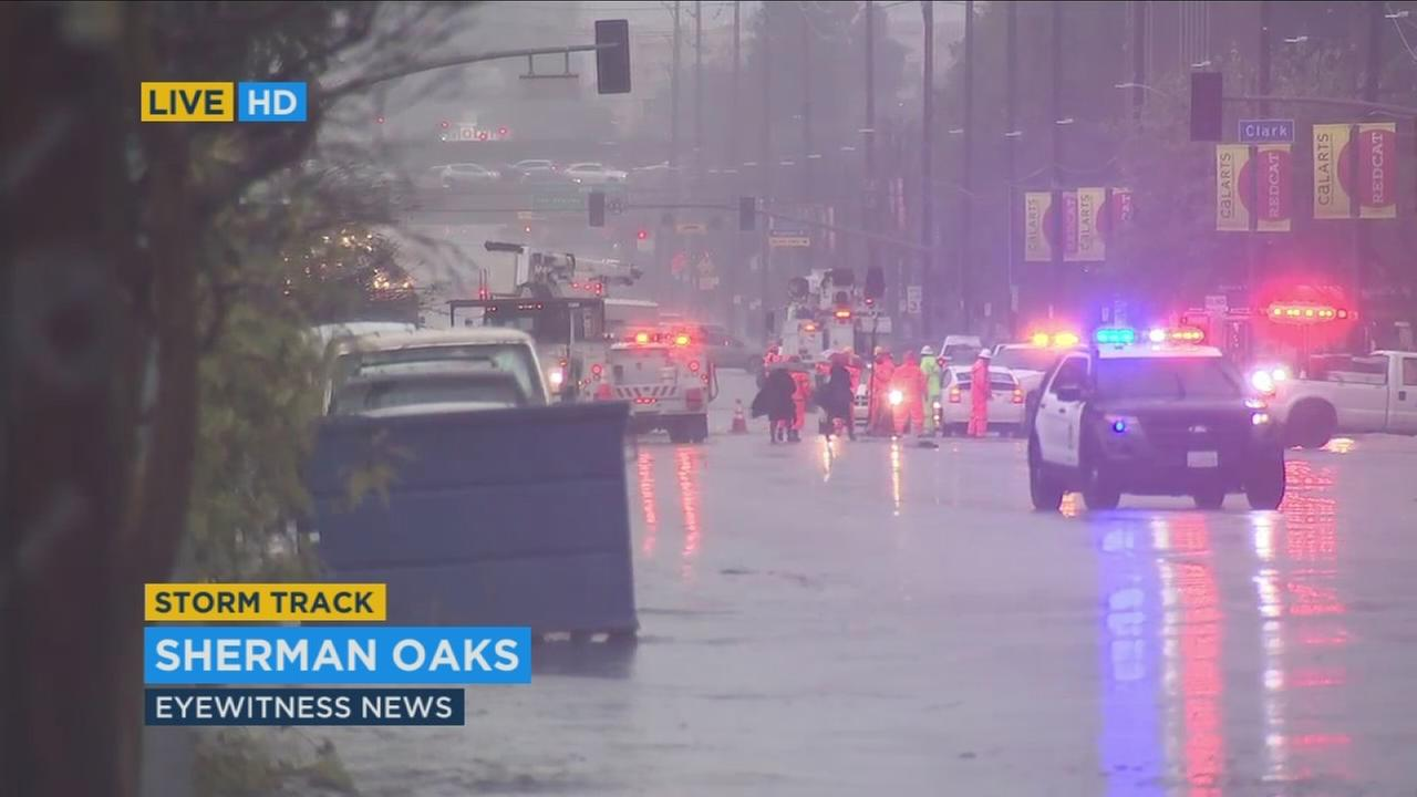 A 55-year-old man was killed Friday after a power pole crashed down in the Van Nuys-Sherman Oaks area amid the massive rainstorm.