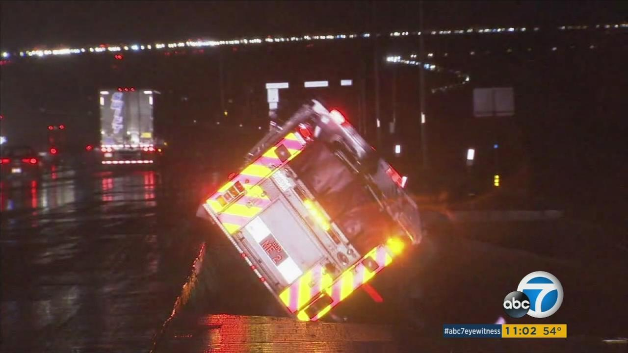 A San Bernardino County fire truck fell over the side of the 15 freeway in the Cajon Pass when the rain-soaked roadway gave out. No firefighters were injured.KABC