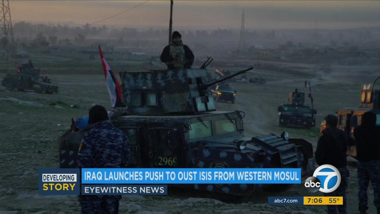 U.S.-backed Iraqi forces launched a large-scale military operation on Sunday to dislodge Islamic State militants from the western half of Mosul, the latest phase in a four-month-old offensive to retake Iraqs second largest city.