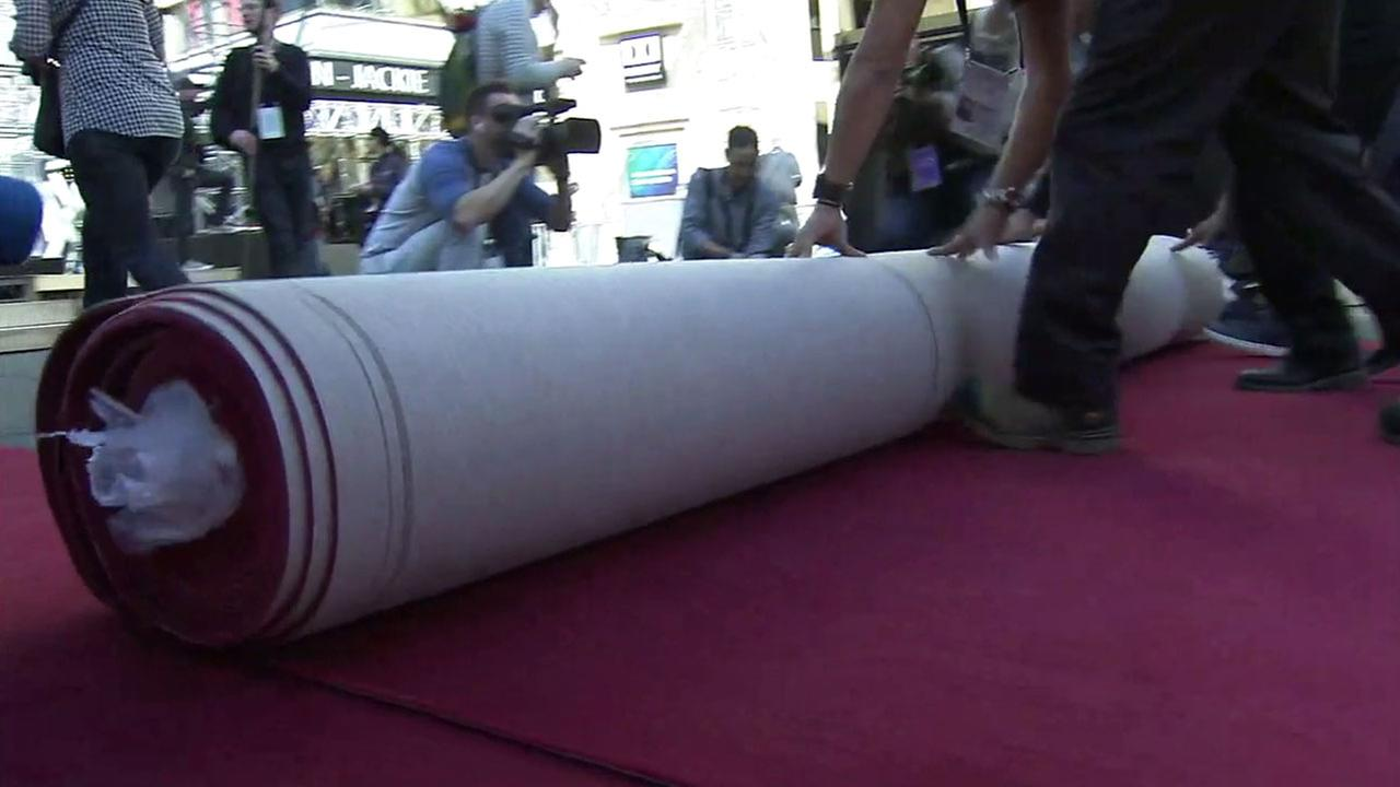 Crews roll out the Oscars red carpet while preparations are underway on Wednesday, Feb. 22, 2017.