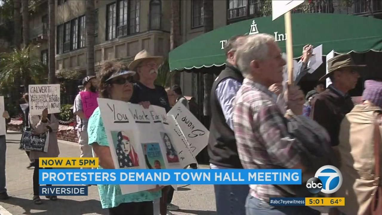 Demonstrators held a protest outside the Mission Inn Hotel and Spa, where Rep. Ken Calvert held a fundraiser luncheon on Wednesday, Feb. 22, 2017.