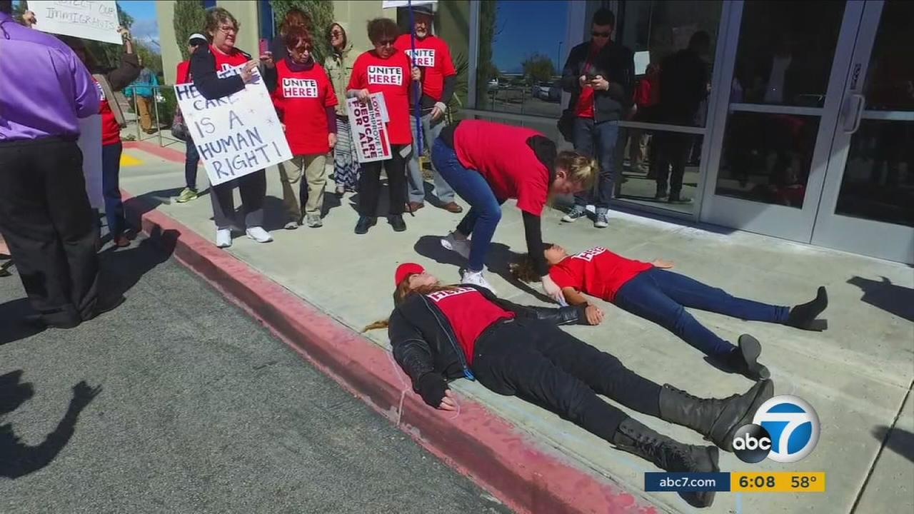 Protesters showed up at the offices of Republican members of Congress throughout Southern California on Thursday.