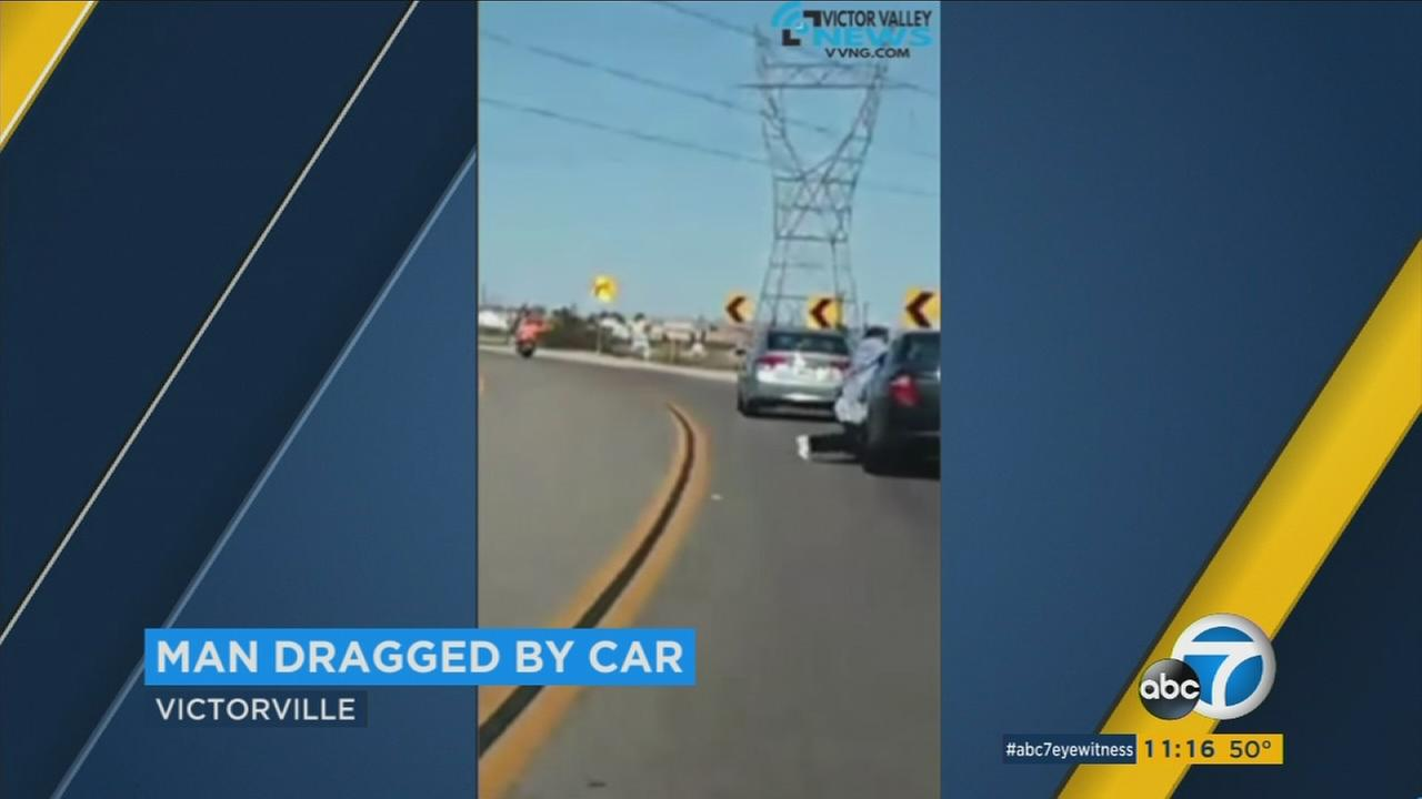 A man is dragged by a car after a suspect in the vehicle snatched up his puppy in Victorville.