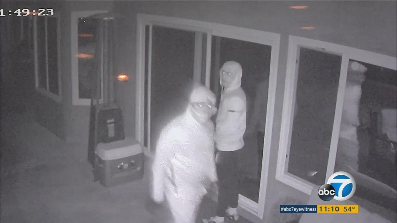 Surveillance video from January shows two suspects breaking into a Porter Ranch home and stealing thousands of dollars of valuables.