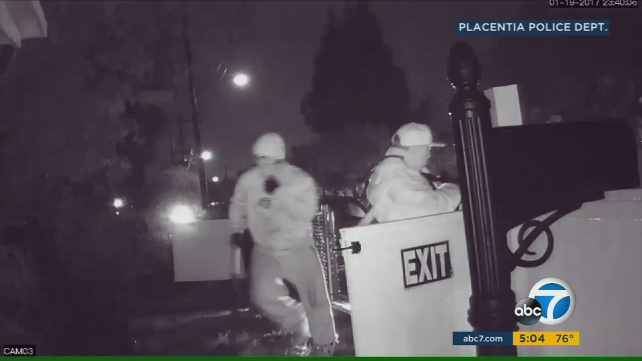 Murder suspects caught on camera wielding guns outside a home in Placentia, where a man was shot and killed on Jan. 19 in Placentia.