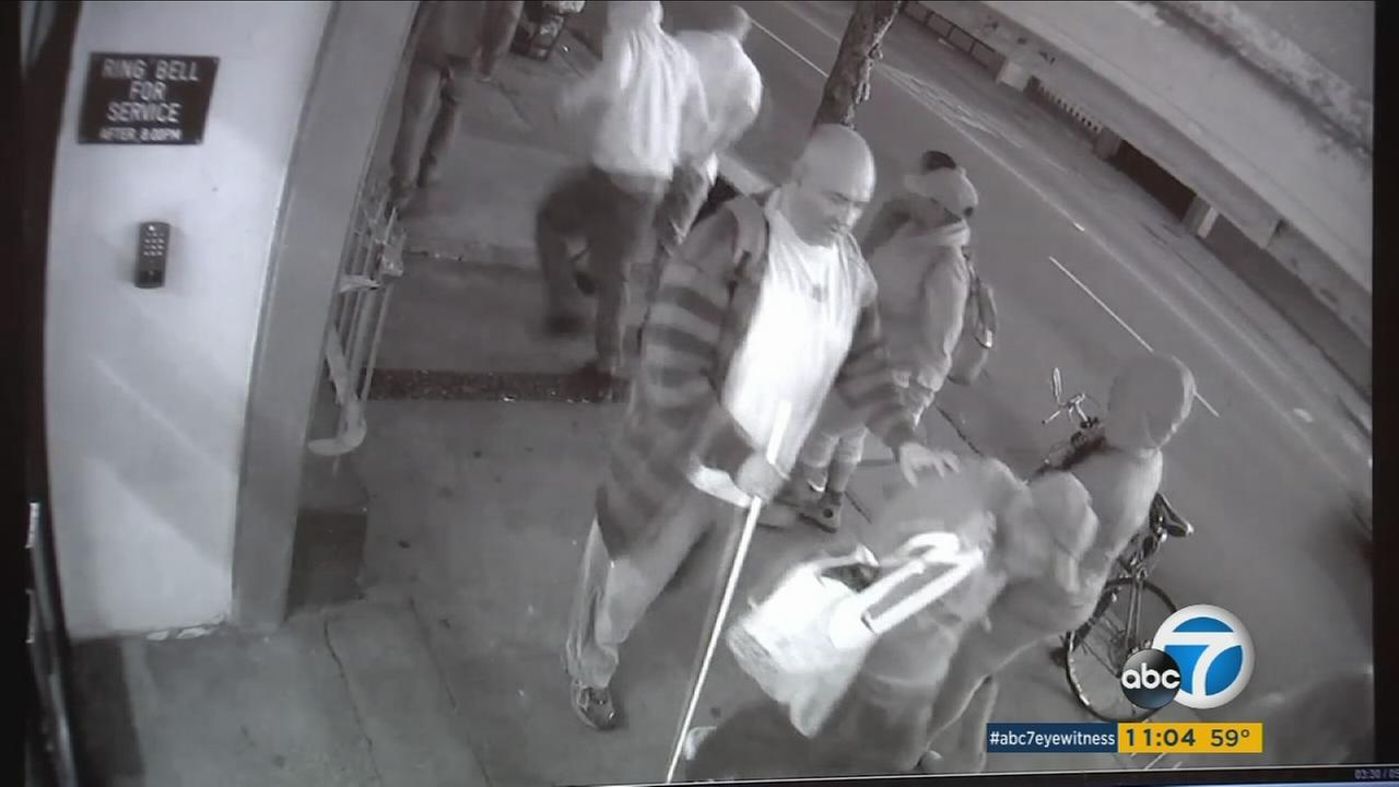 Surveillance video shows a robbery in progress in downtown Los Angeles.