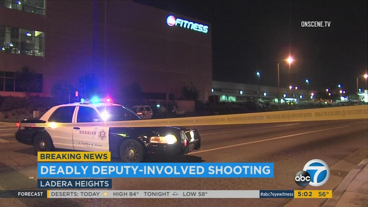 A Los Angeles County sheriffs deputy fatally shot an armed man outside a gym in Ladera Heights on Tuesday, March 7, 2017, authorities said.