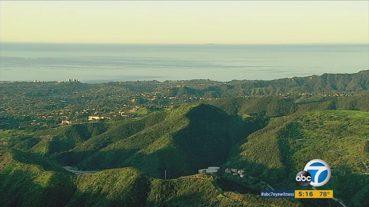 Rain has turned the Southern California hillsides a verdant shade but brings an increased risk of landslides.