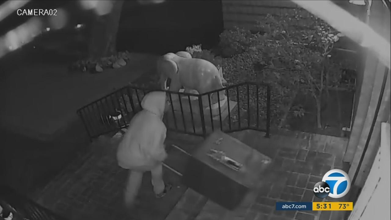 A burglary suspect is shown on surveillance camera robbing a San Marino home.