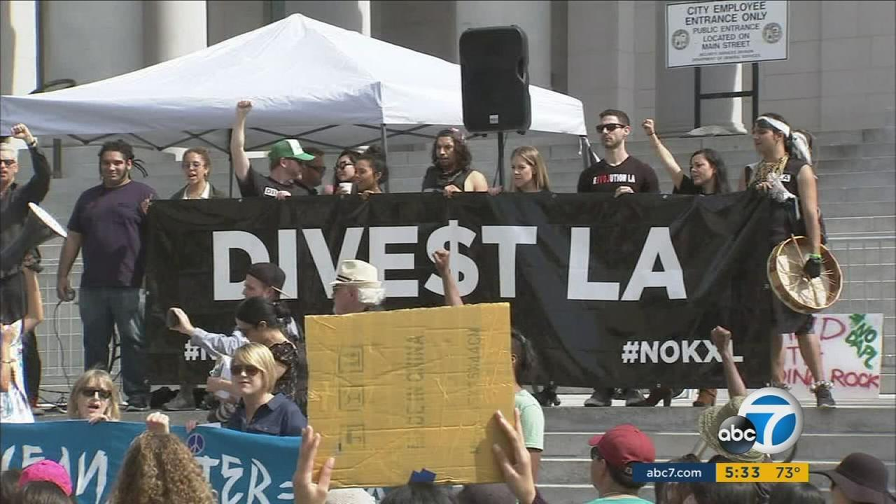Protesters with Divest L.A. urge the Los Angeles City Council to sever ties with Wells Fargo Bank to stop construction of the Dakota Access Pipeline.