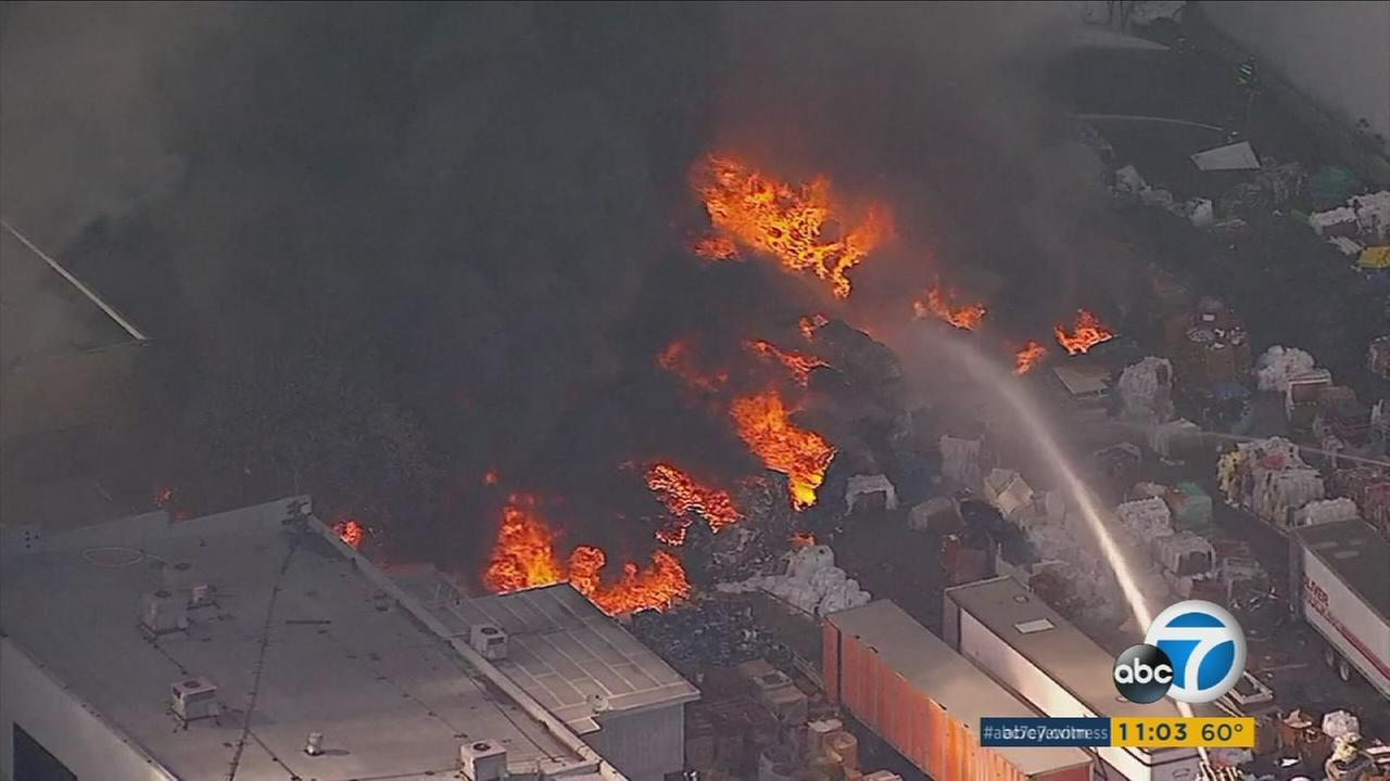 A close-up image captured by AIR7 HD shows flames engulfing a structure in a plastic recycling facility in Santa Fe Springs on Monday, March 13, 2017.