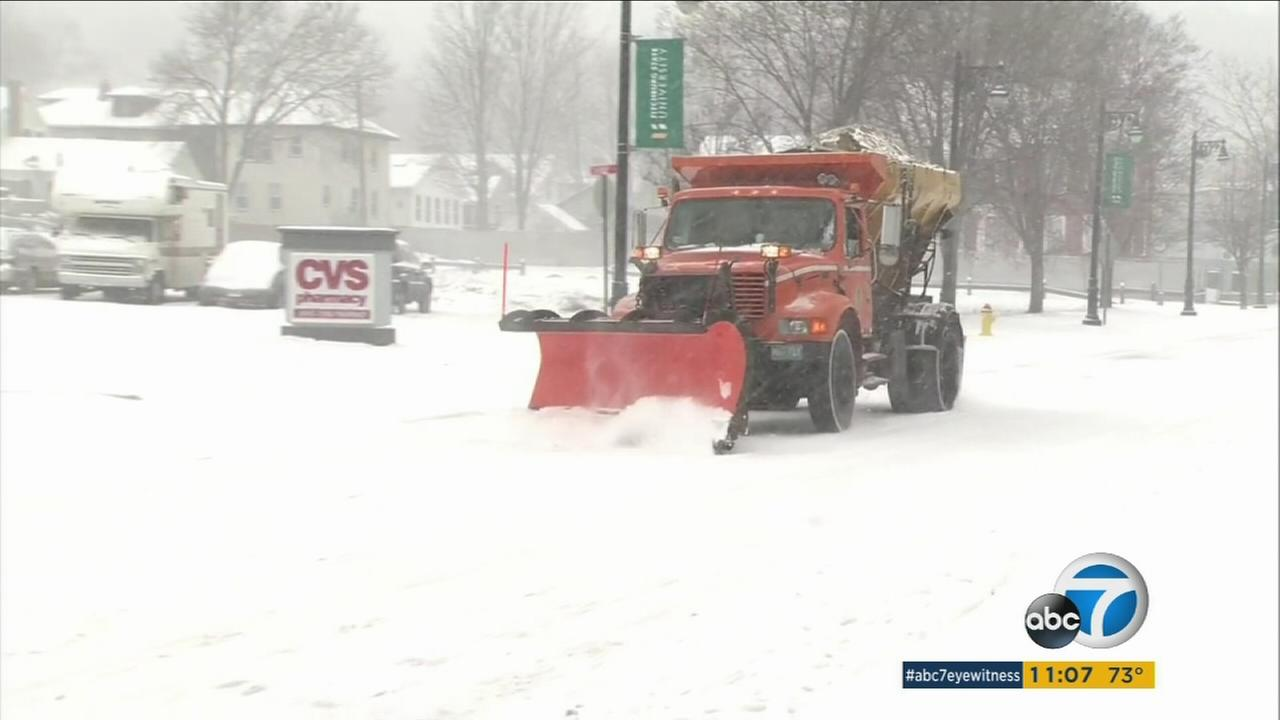 A plow clears snow piled up in the Northeast.