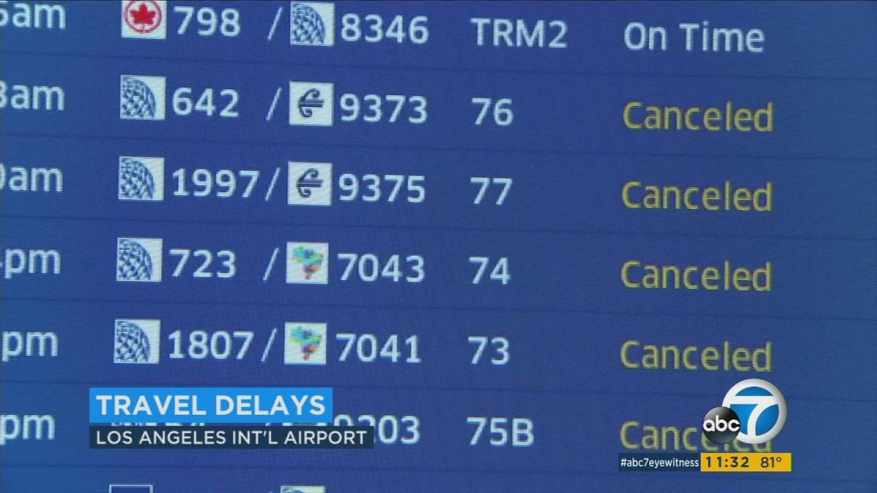 An electronic display board at Los Angeles International Airport lists canceled flights on Tuesday, March 14, 2017.