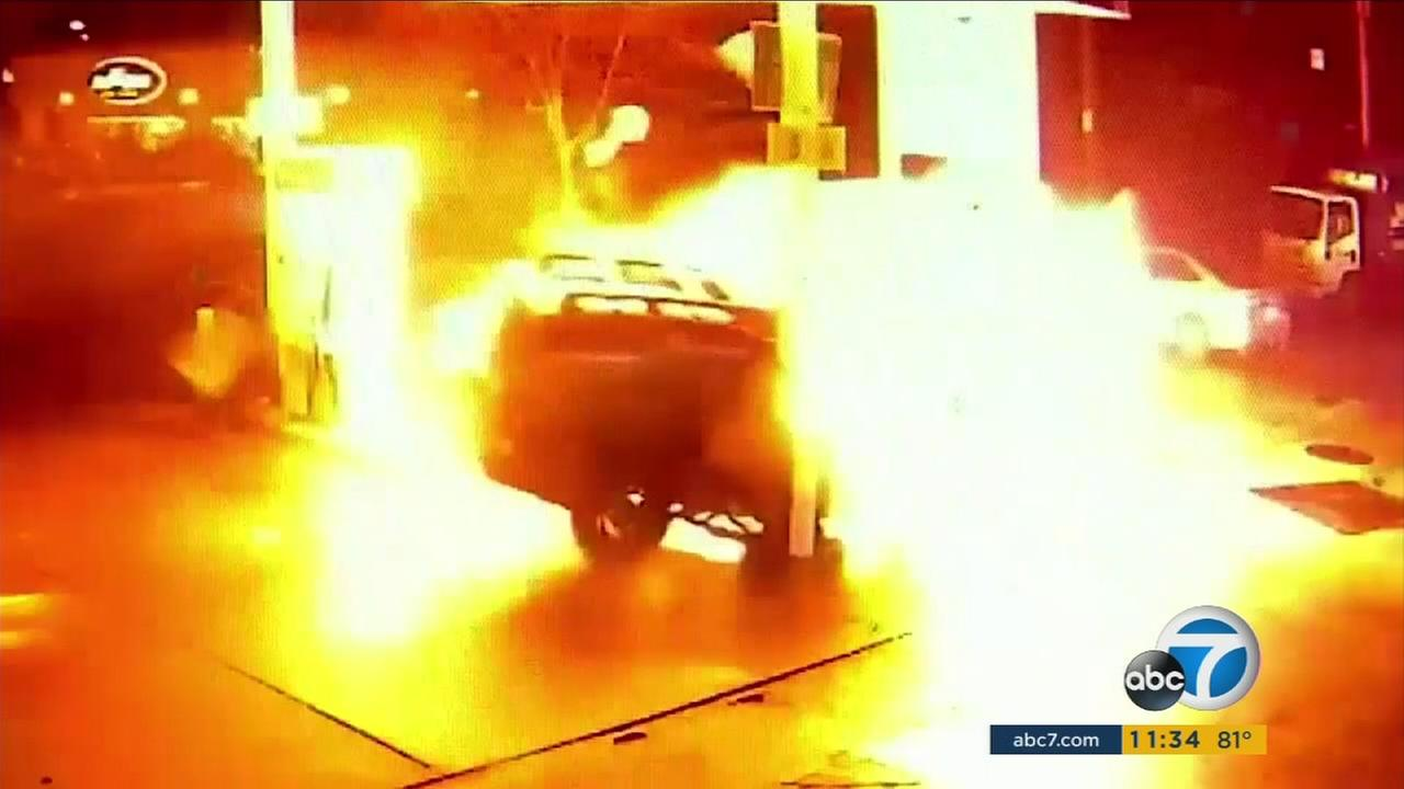 Surveillance video caught a fiery crash as an SUV slammed into pumps at a gas station in Seattle, setting them on fire.