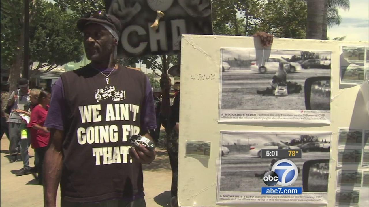Protesters gather at Leimert Park to voice their outrage at the beating of a homeless woman by a California Highway Patrol officer on Saturday, July 12, 2014.