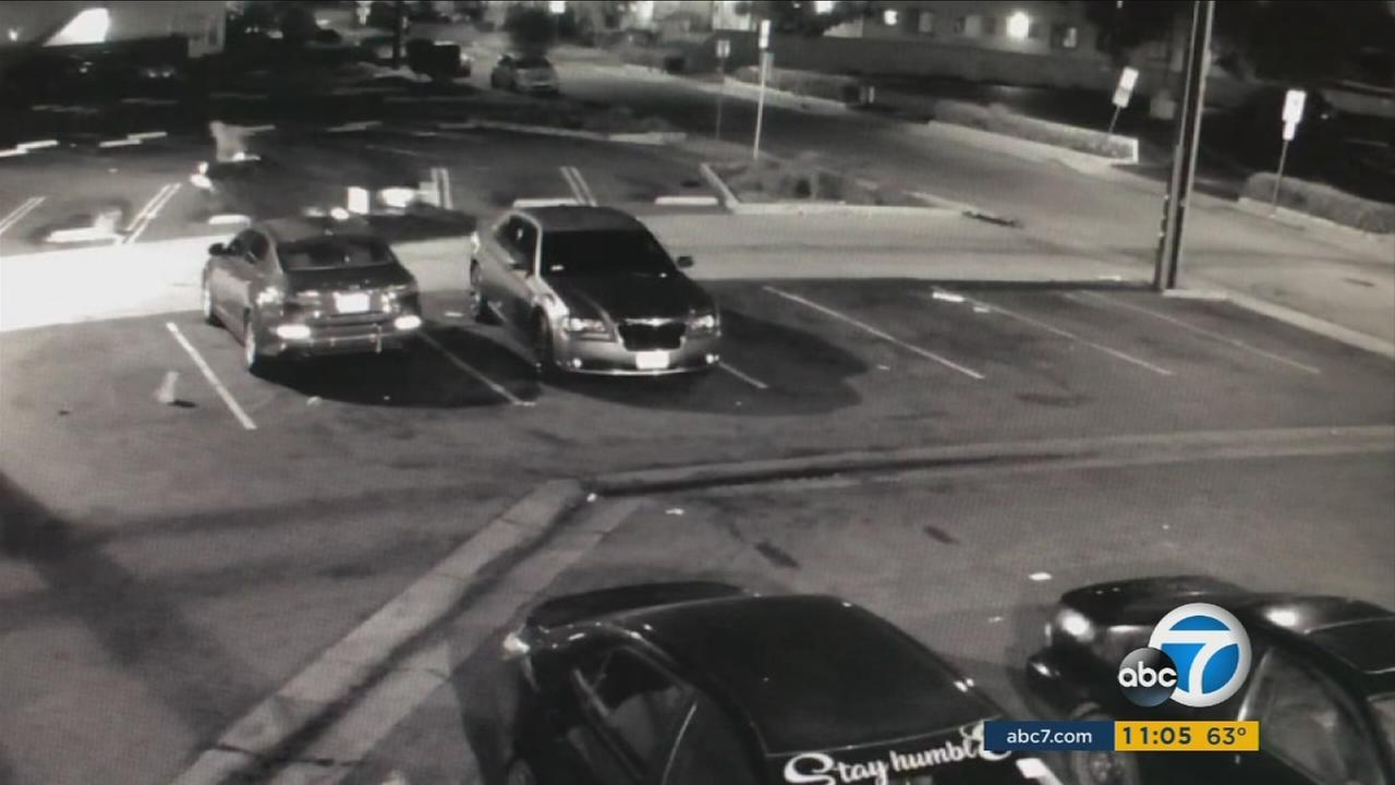 Surveillance video shows the moment a robbery suspect was mowed down by a victims car, causing the suspect to shoot himself in the head on Wednesday, March 15, 2017.
