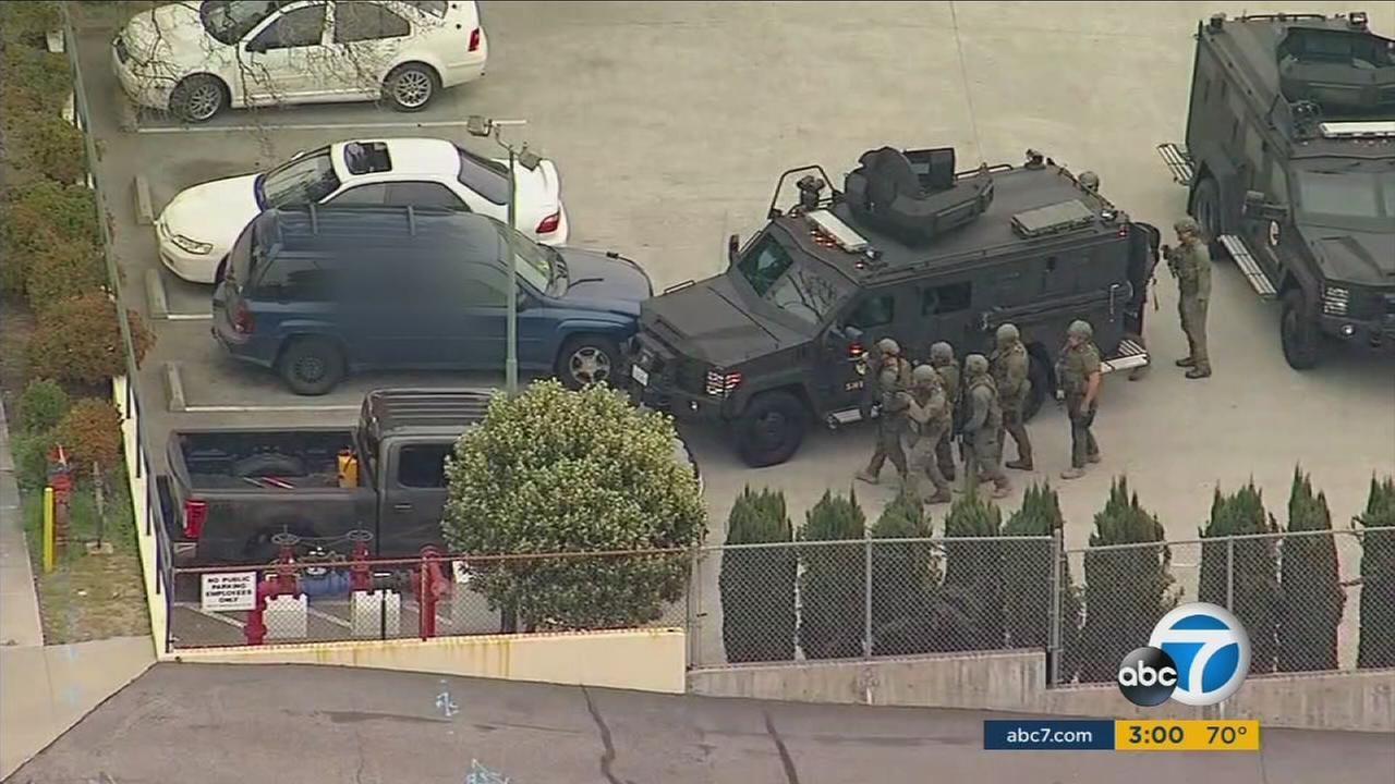 Authorities surrounded a vehicle where a shooting suspect was holed up on Monday, March 20, 2017.
