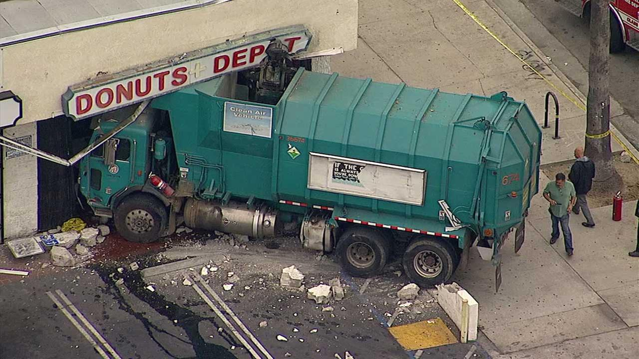 A sanitation truck crashed into a business on Tuesday, March 21, 2017.
