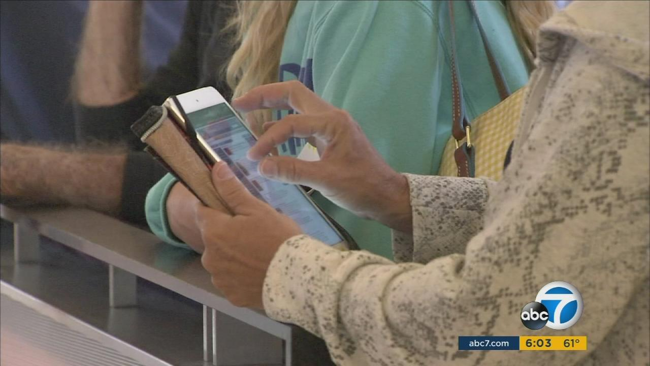 A traveler holds an iPad at Los Angeles International Airport in an undated photo.