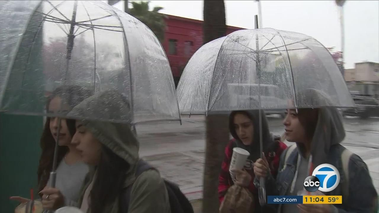 The umbrellas were out again around Los Angeles as more rain fell on Tuesday, while even more is expected this week.