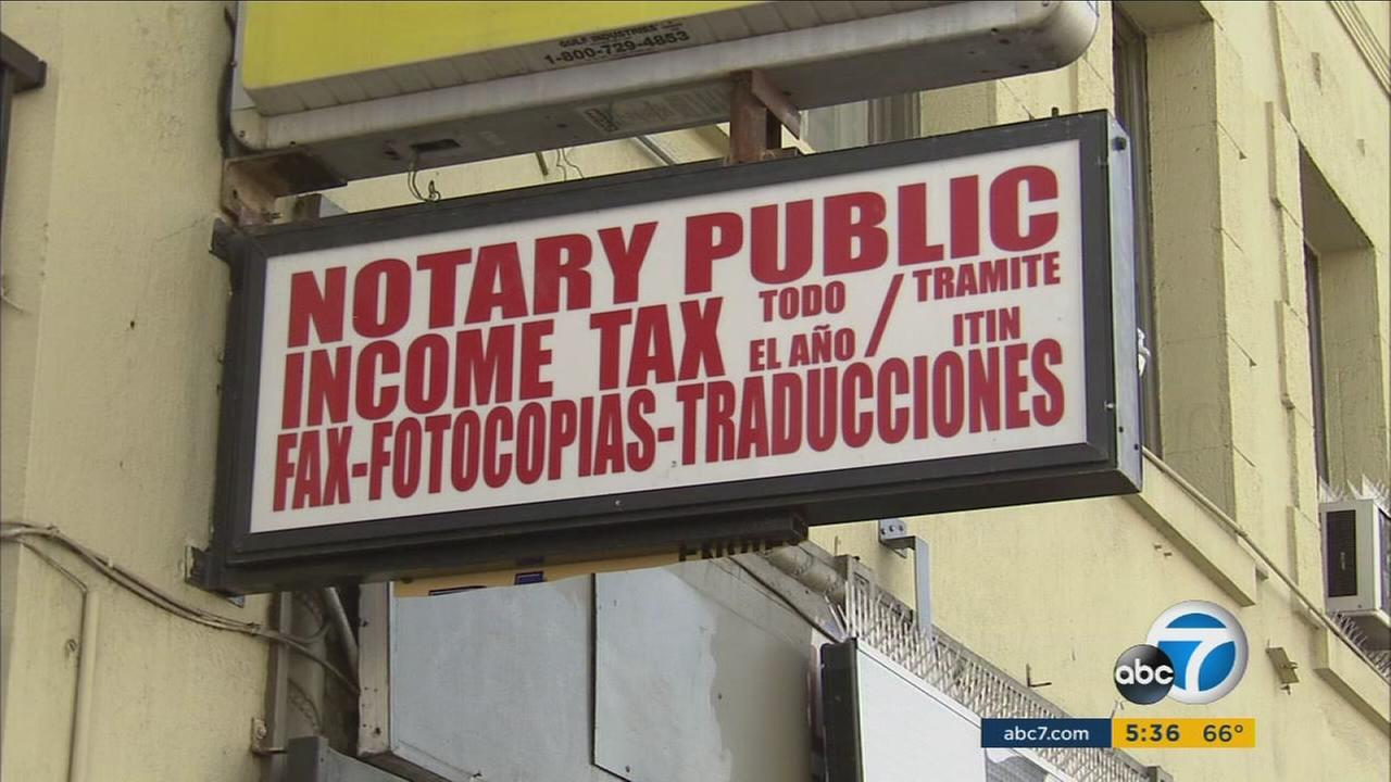 A business sign advertises income tax preparation and notary services in an undated file photo.