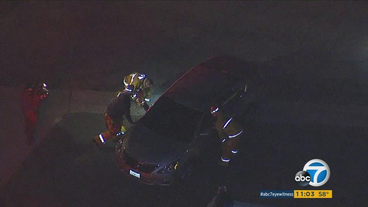 Woman trapped in car after power line knocked down in Monterey Park