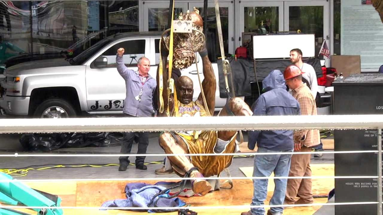 Crews get ready to hoist a 9-foot, 1,200-pound bronze statue of Laker great Shaquille ONeal at Staples Center.