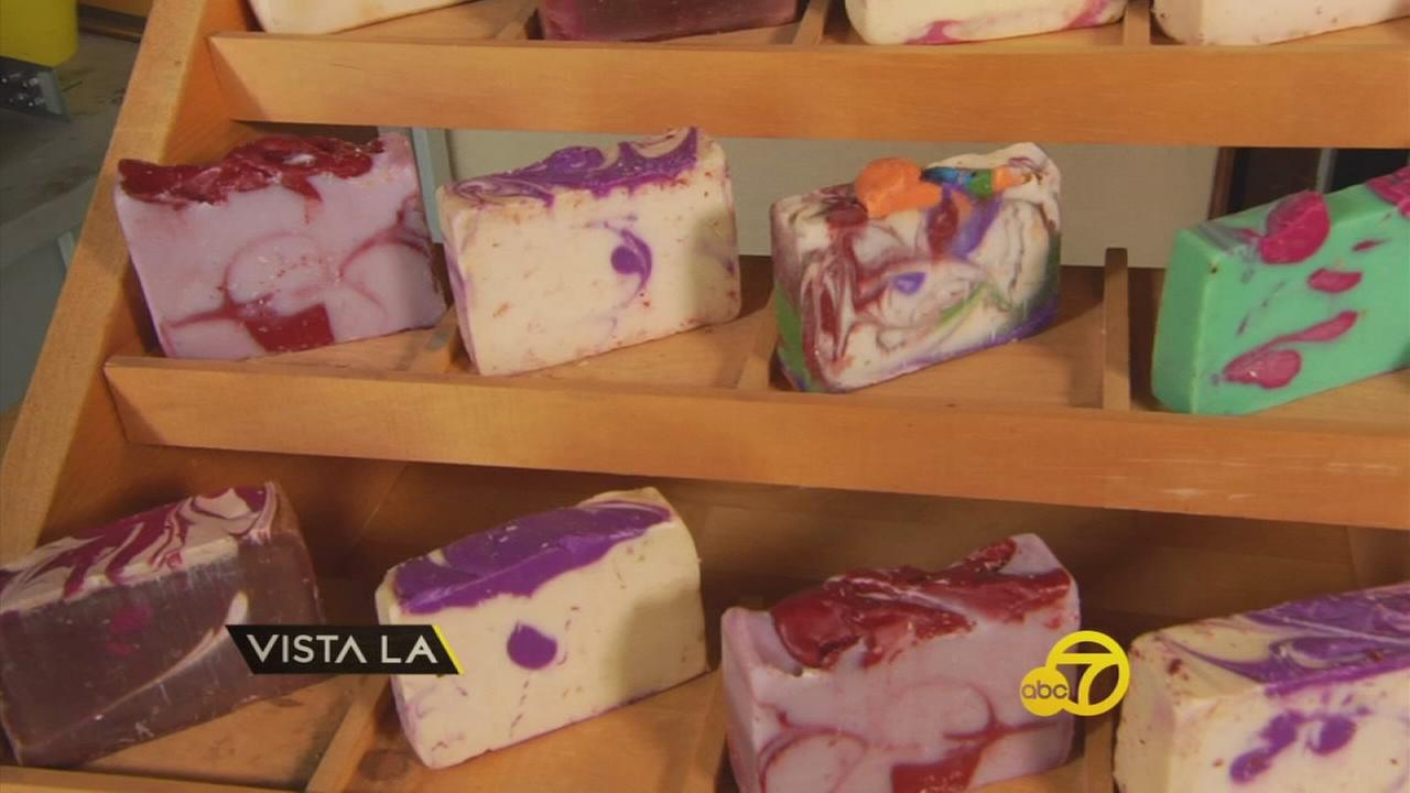 A container of different natural soaps is shown in Marcela Arrietas garage.