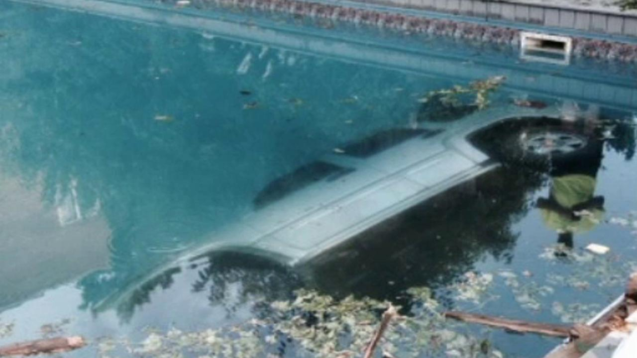 An SUV is seen after it crashed into a pool in Ohio on Saturday, July 12, 2014.