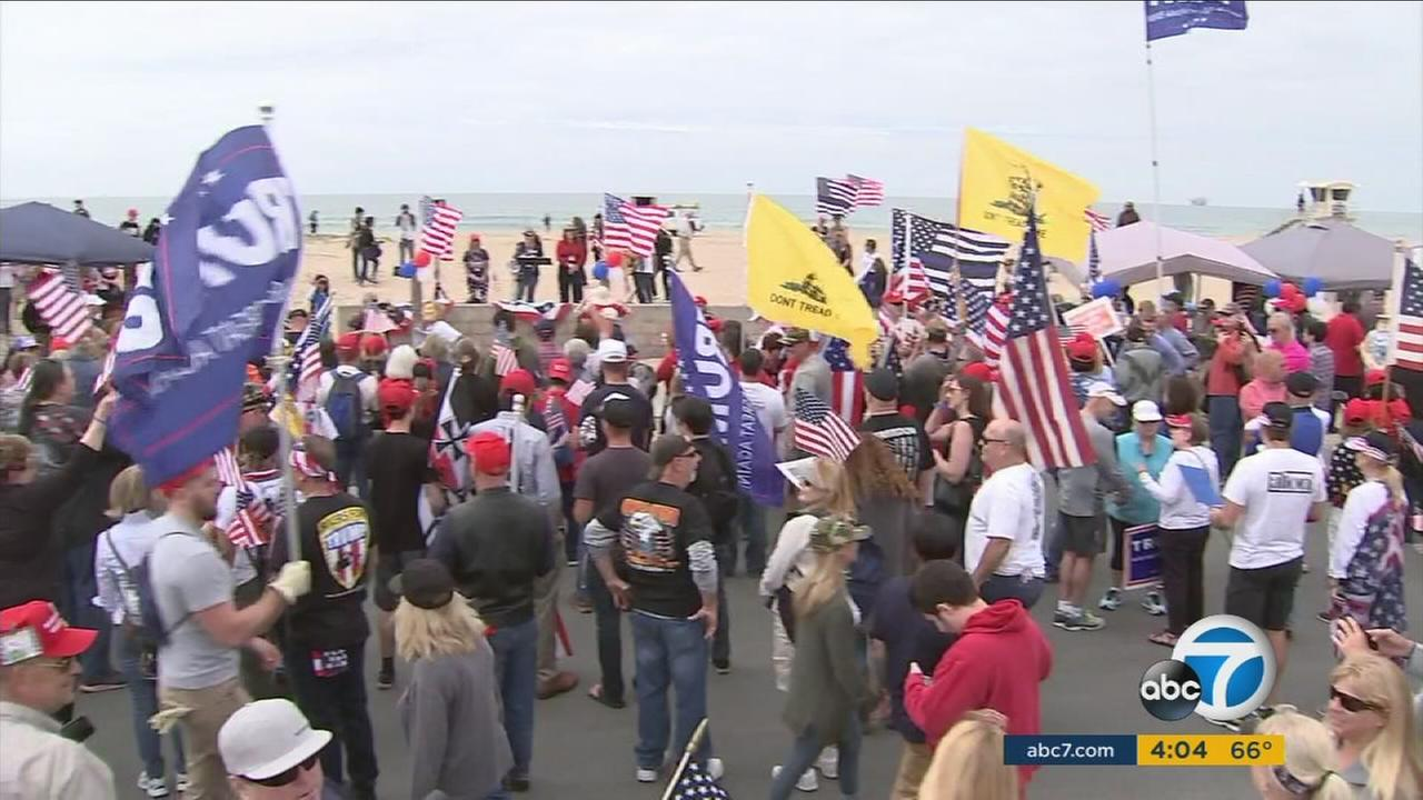 Trump supporters and some protesters are shown during a march and rally at Bolsa Chica State Beach on Saturday, March 25, 2017.