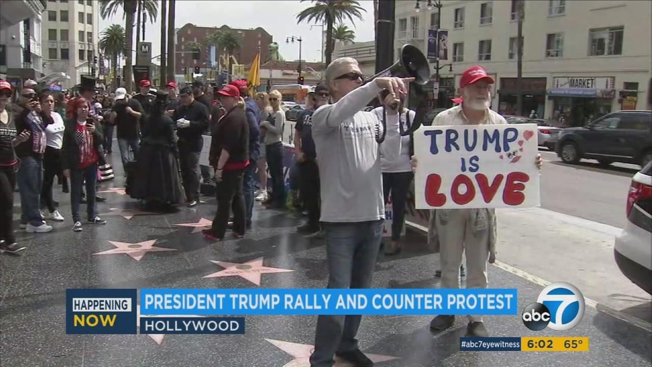 Trump supporters held a sign saying Trump is Love during a support rally at his Hollywood Walk of Fame star on Saturday, March 25, 2017.