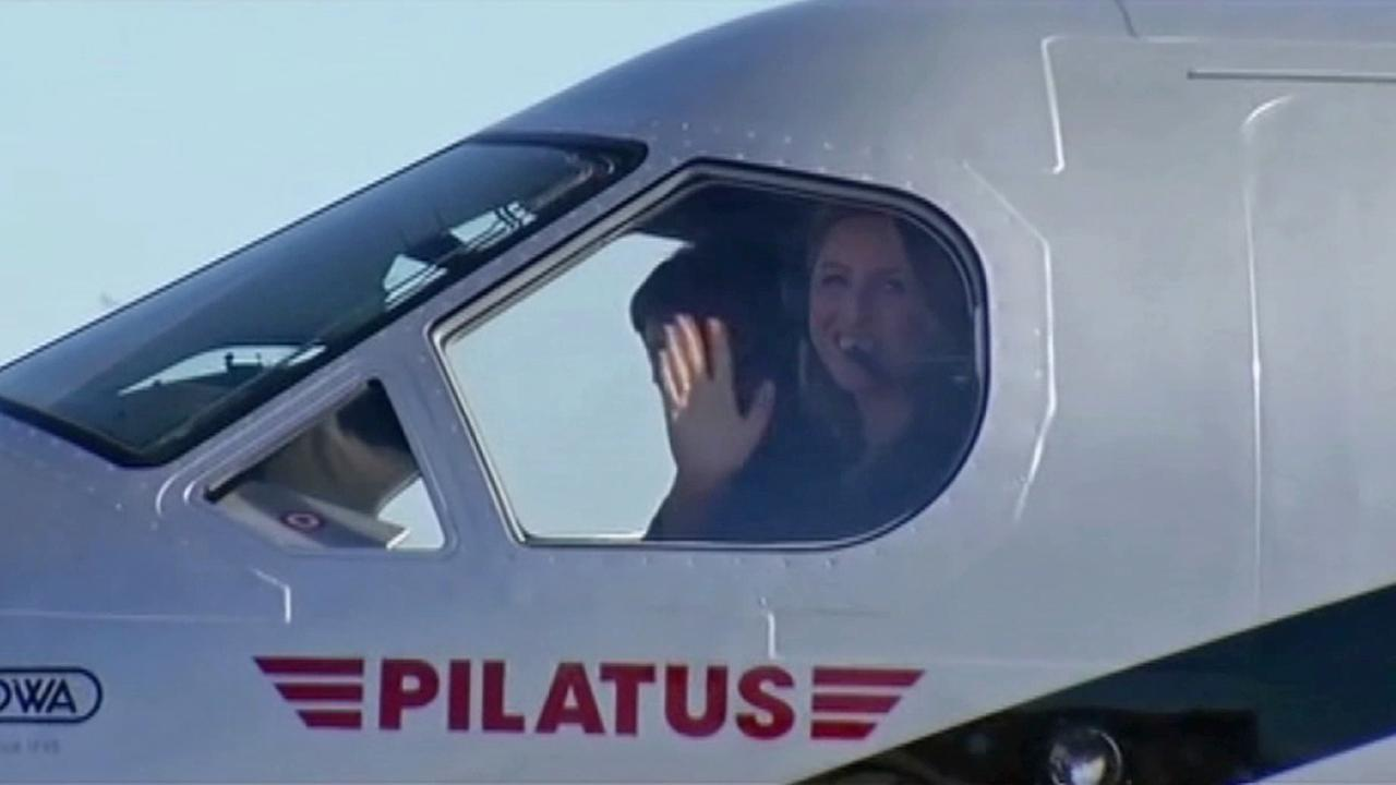 Amelia Rose Earhart, 31, lands at Oakland International Airport after circling the world Friday, July 11, 2014.