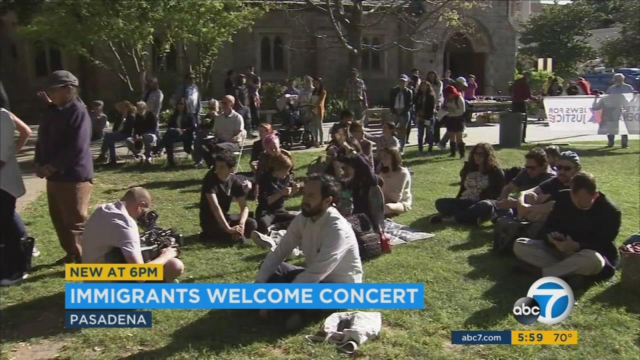 A group of people gather at a concert to promote better protections for immigrants in Pasadena on Monday, March 27, 2017.
