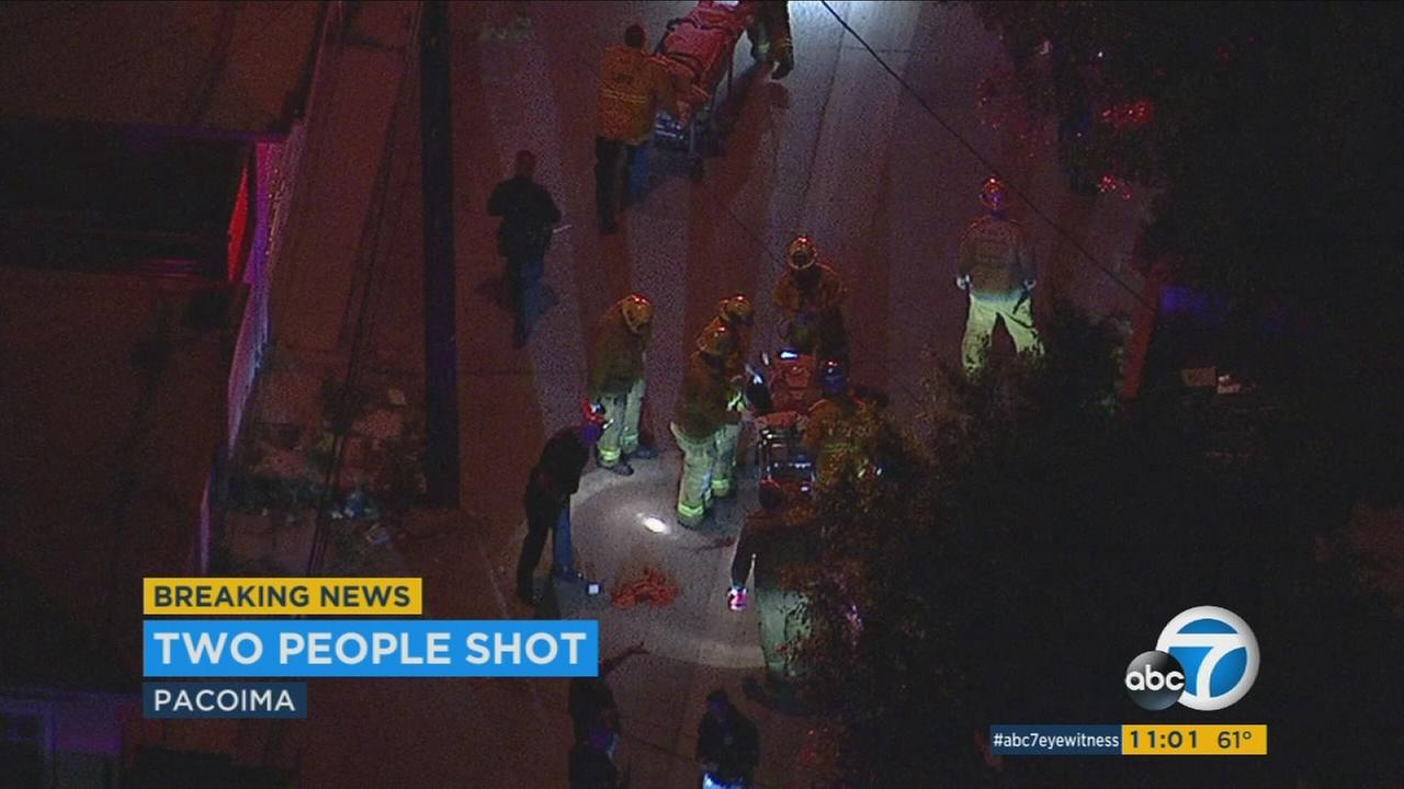 Two people were found shot and badly wounded in an alley in Pacoima Friday night, officials said.