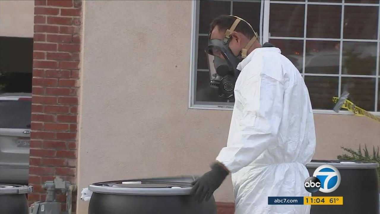 Investigators at the scene of a drug lab explosion in Pasadena on Monday, April 3, 2017.