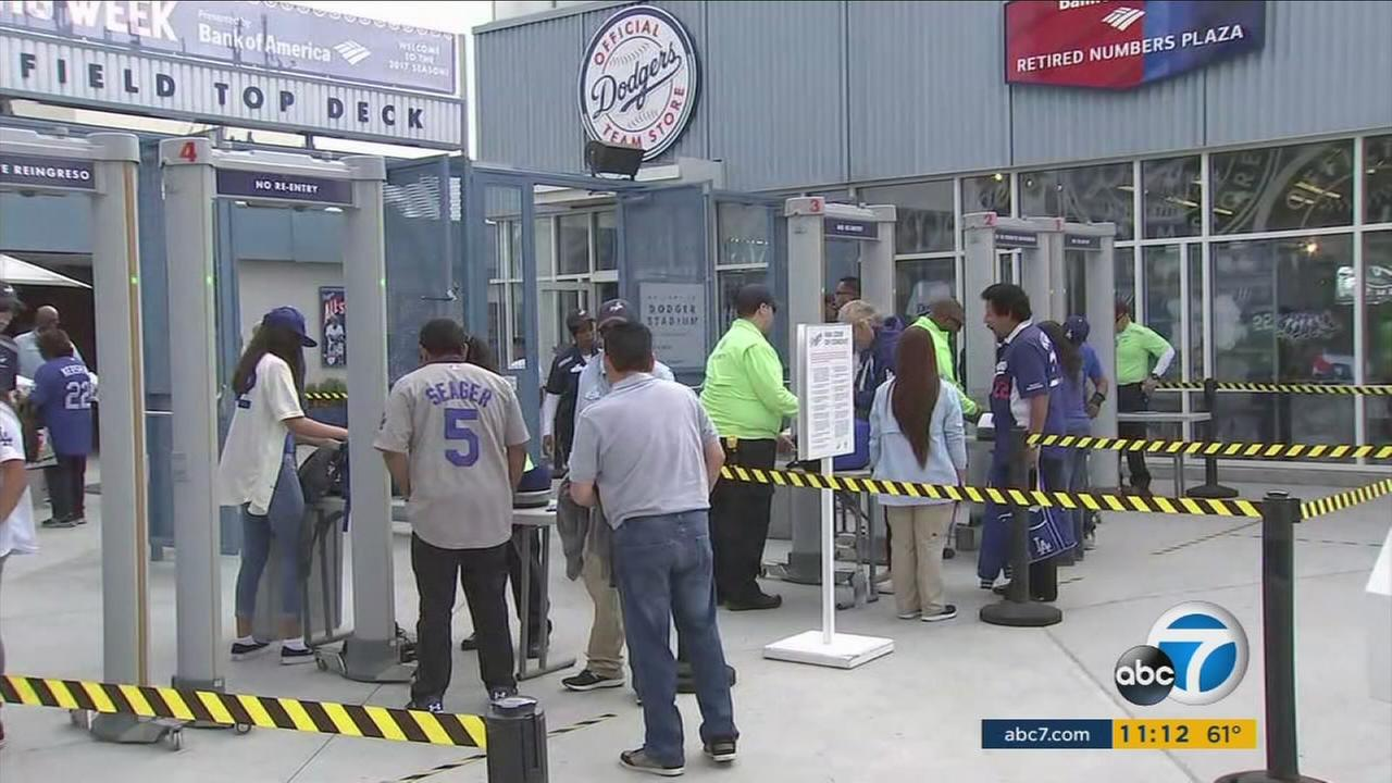 Dodgers fans line up to enter the stadium on Opening Day, Monday, April 3, 2017.