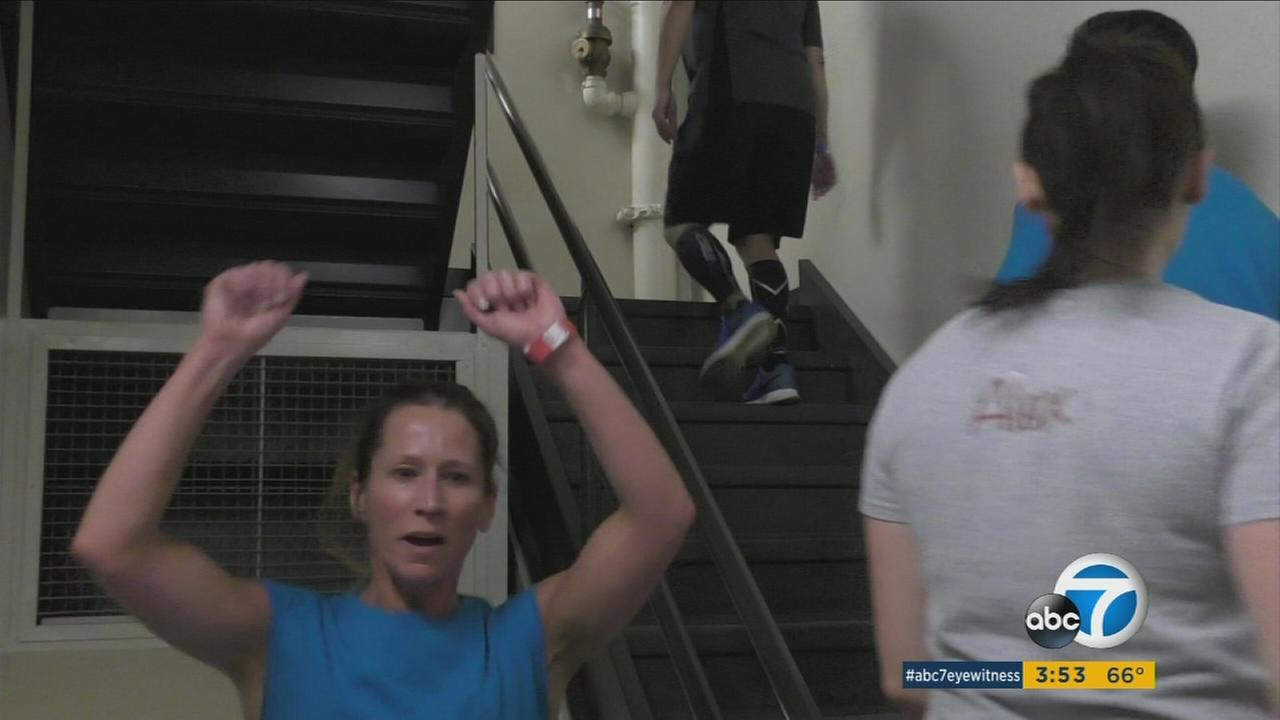 More than 1,000 people are expected to climb up 63 flights of stairs at downtown LAs AON skyscraper to raise funds for the American Lung Association.