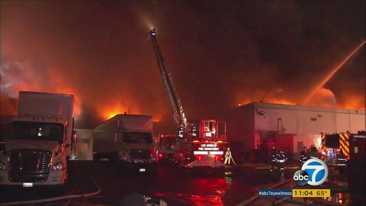 Fire crews battle a massive building fire in South Los Angeles on Monday, April 3, 2017.